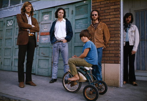 The Doors and Little Boy on Sidewalk